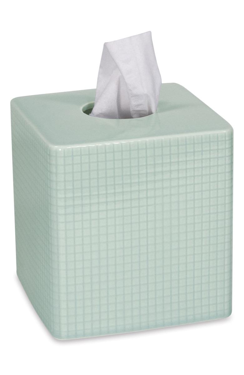 green tissue box, bathroom accessories