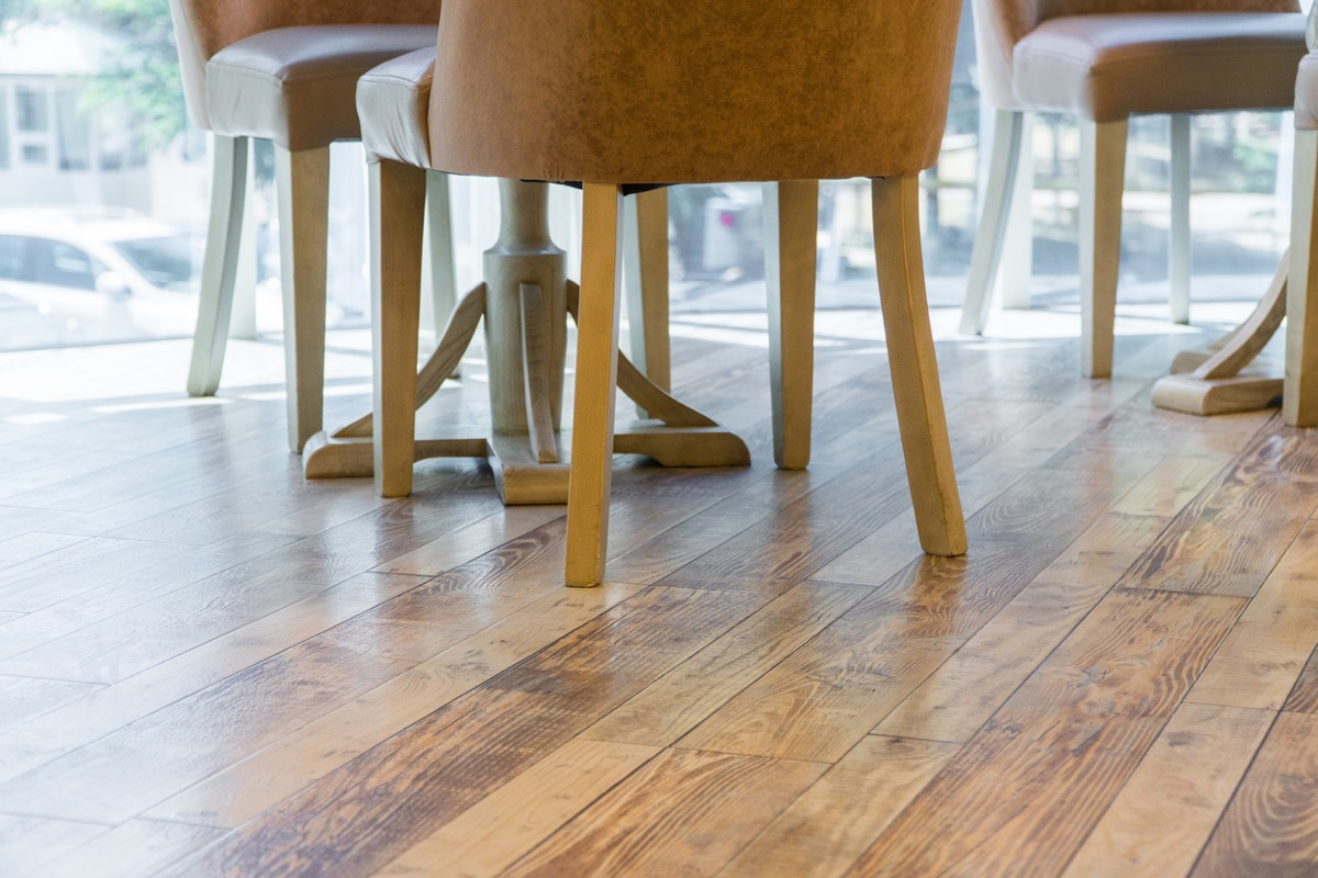 close-up of legs of chairs on the wooden floor