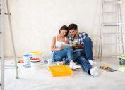 a couple paints a room