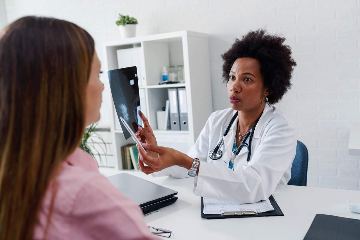 female doctor showing her patient results from a breast screening