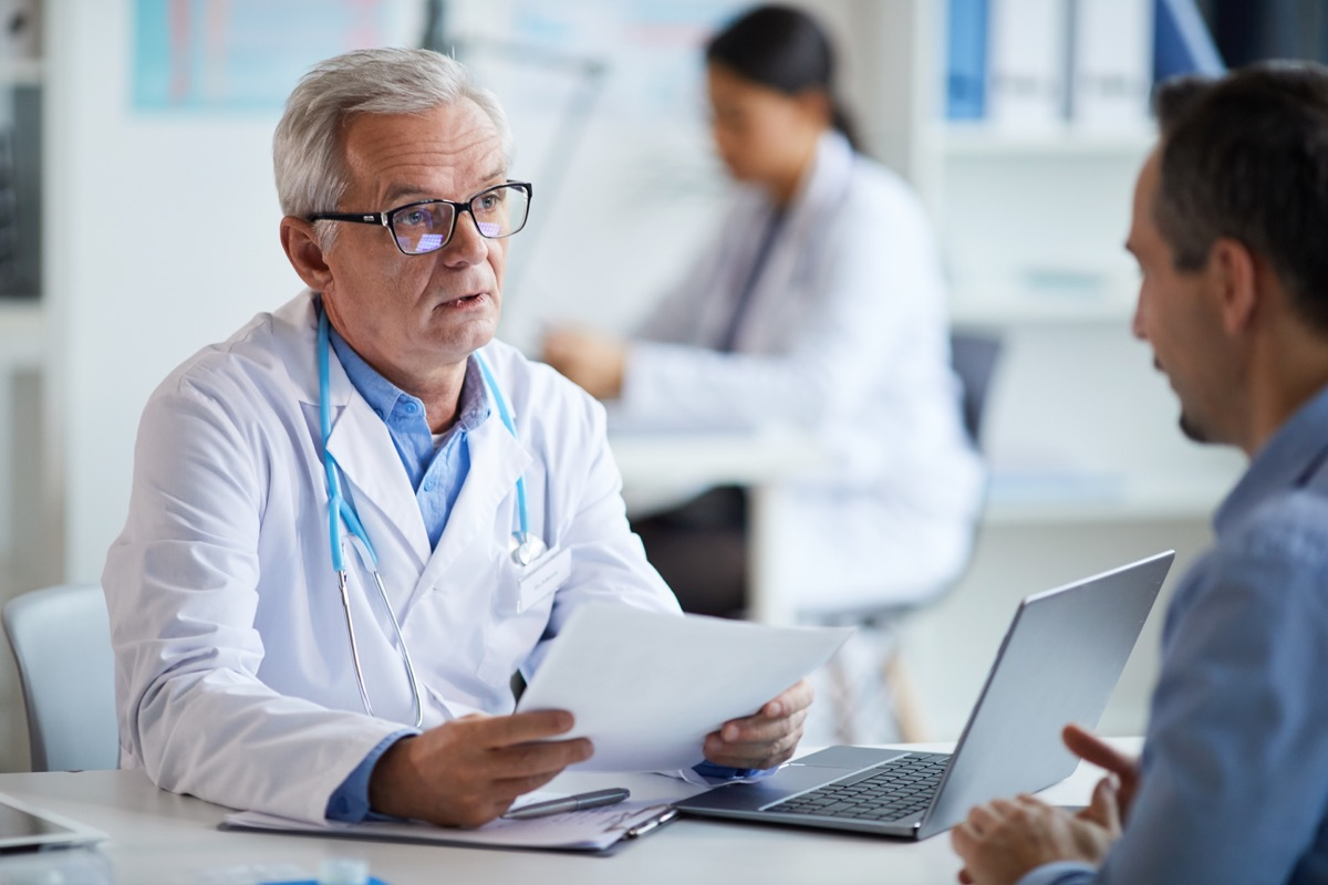 senior doctor talking to his patient and telling him what to do