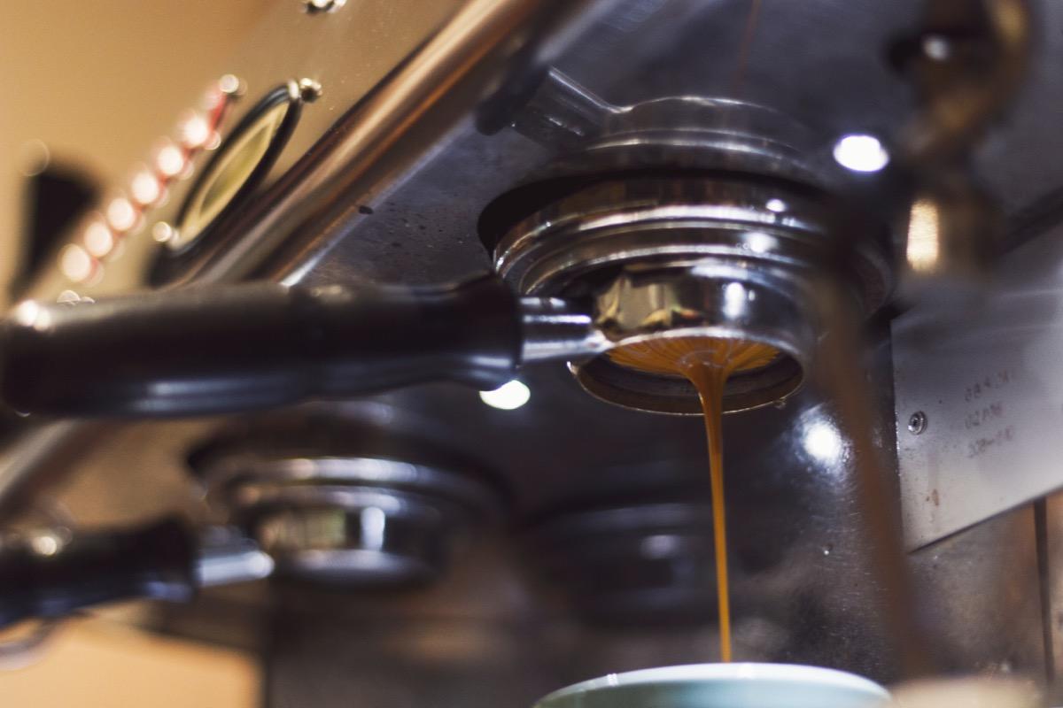 espresso machine drips espresso into cup
