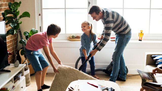 man and two children cleaning living room, earth friendly cleaning products