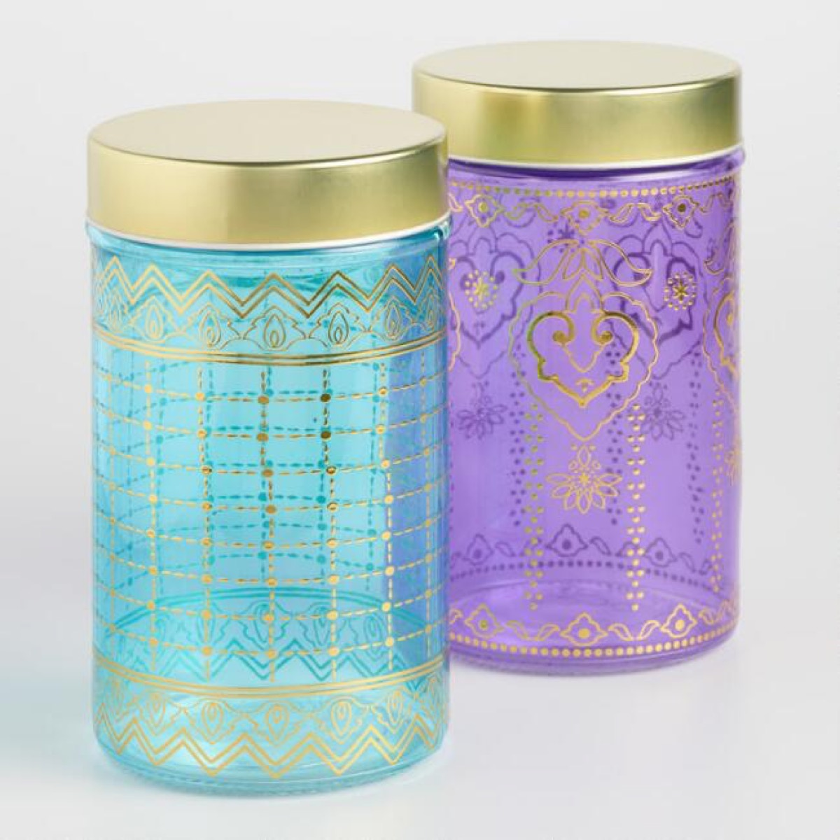 purple and green gold-topped storage containers, bathroom accessories