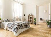 herringbone floor in airy sunny bedroom