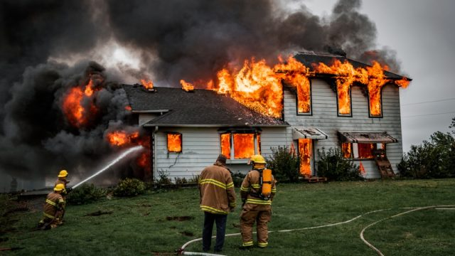 firefighters putting out house fire, fire prevention tips