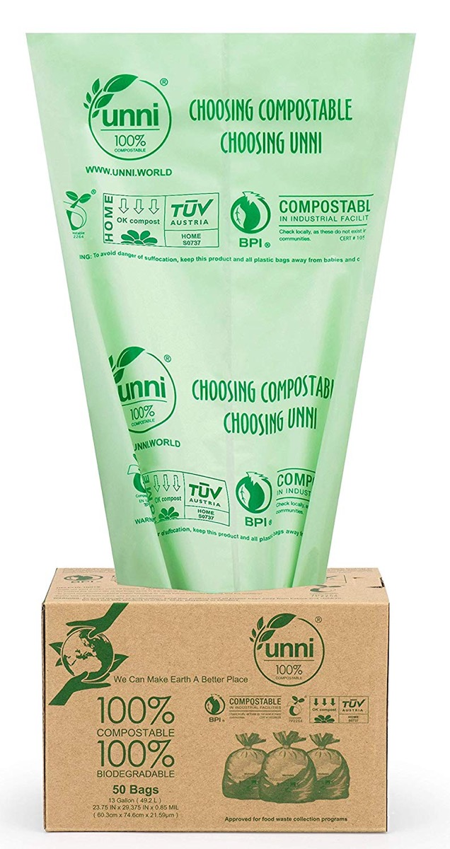 green trash bag coming out of brown box, earth friendly cleaning products