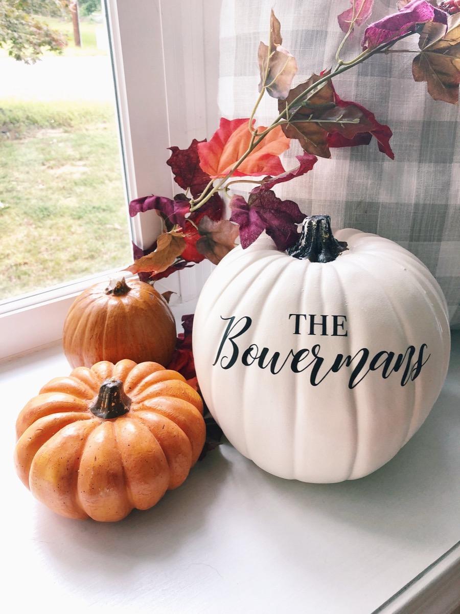 three pumpkins in a windowsill, fall home decor