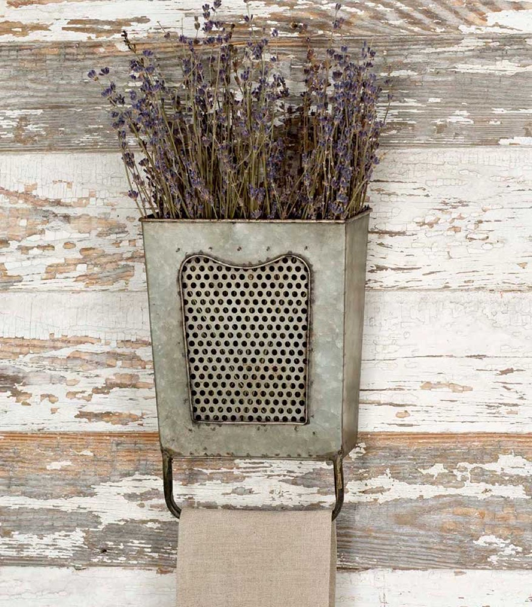 metal bucket with dried flowers on chipped wall, rustic farmhouse decor