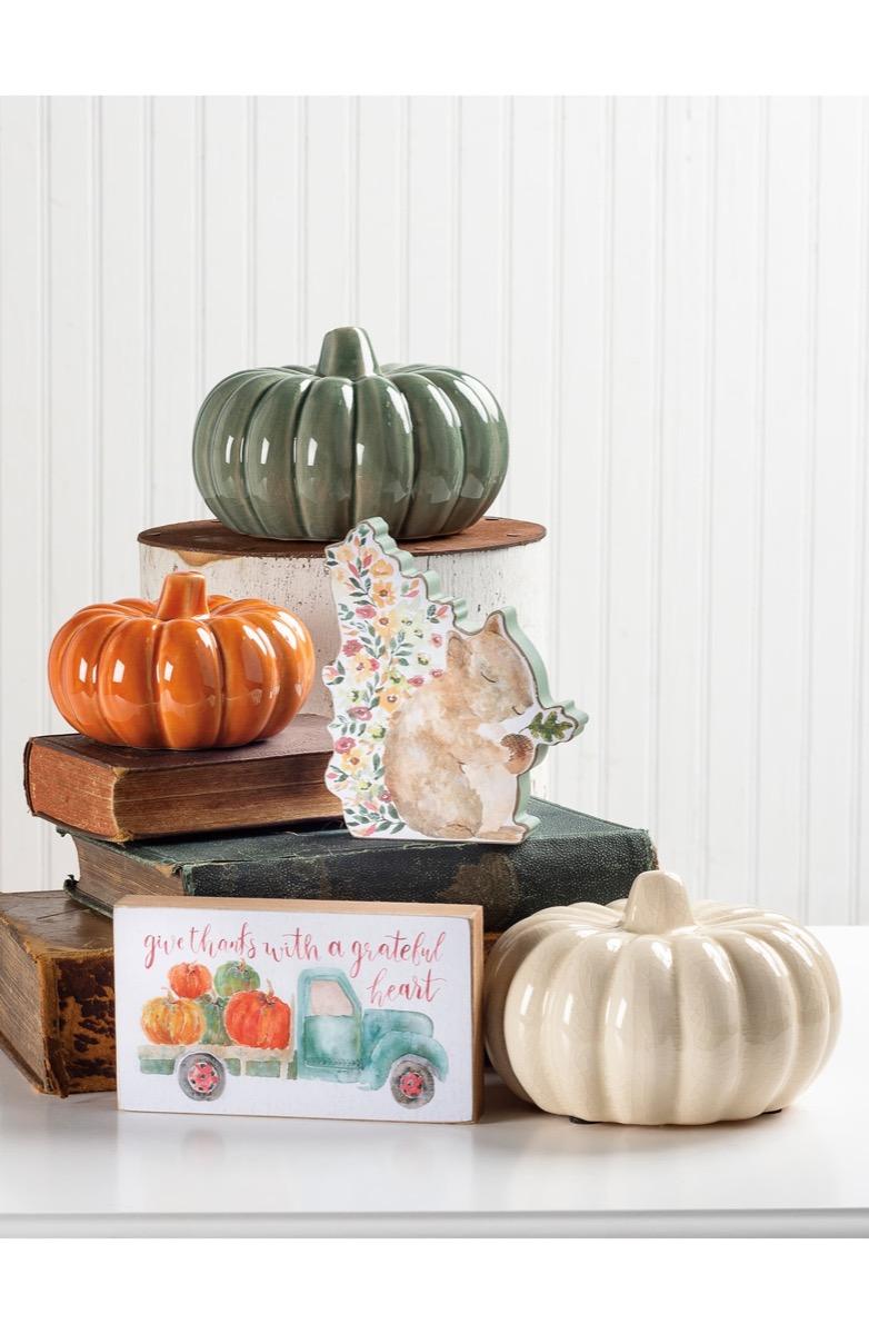 ceramic pumpkins on a side table, fall home decor