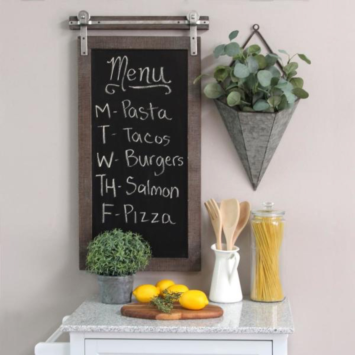 chalkboard sign above white table with plant next to it, rustic farmhouse decor