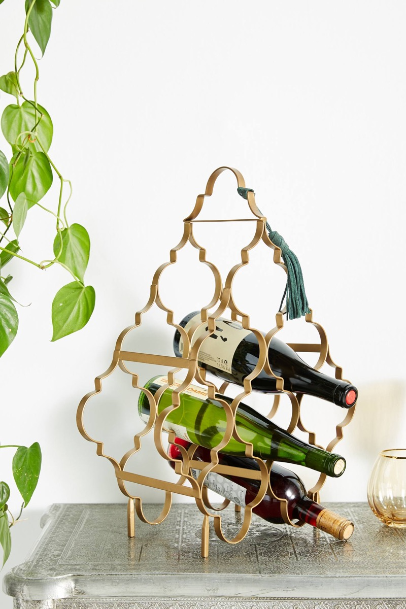 bottles of wine in a gold rack, kitchen decorations