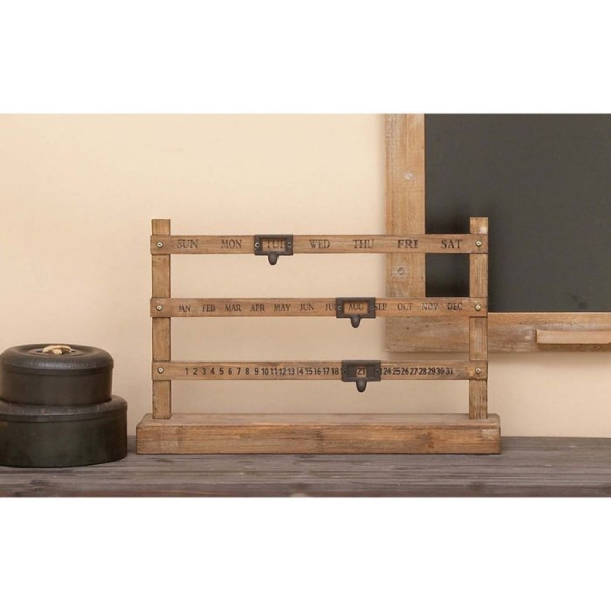 wooden rack on table in front of chalk board, rustic farmhouse decor