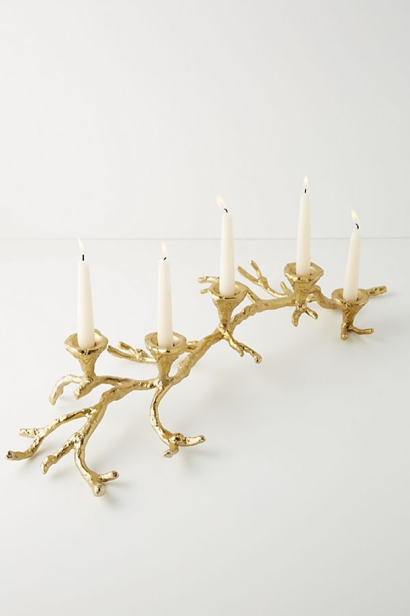 gold candle holder in the shape of a branch, kitchen decorations