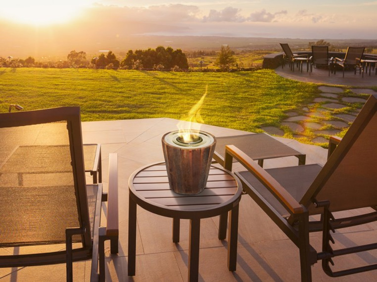 two outdoor chairs with portable fireplace between them, fall home decor