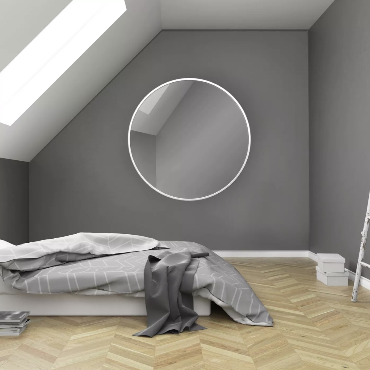 gray room with bed on the floor and round mirror, target home decor items