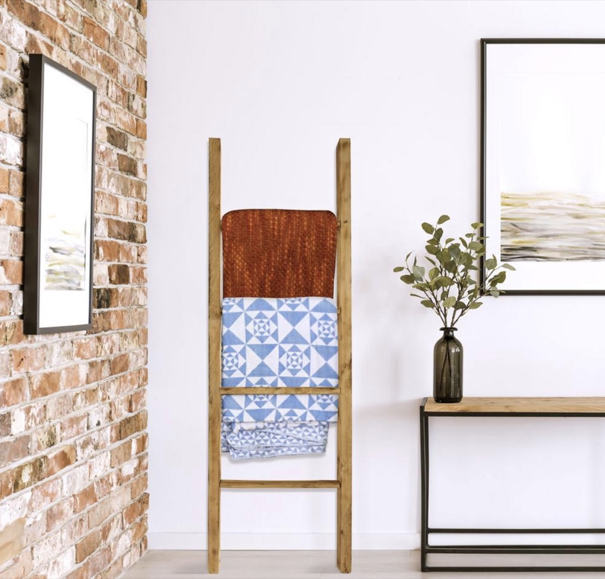 wooden ladder leaning against white wall adjacent to brick wall, rustic farmhouse decor