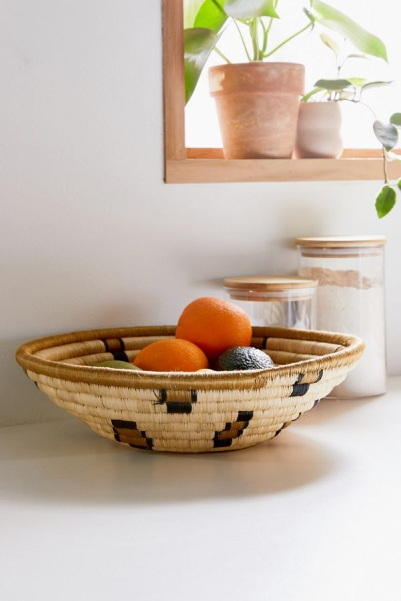 woven bowl with oranges in it, kitchen decorations