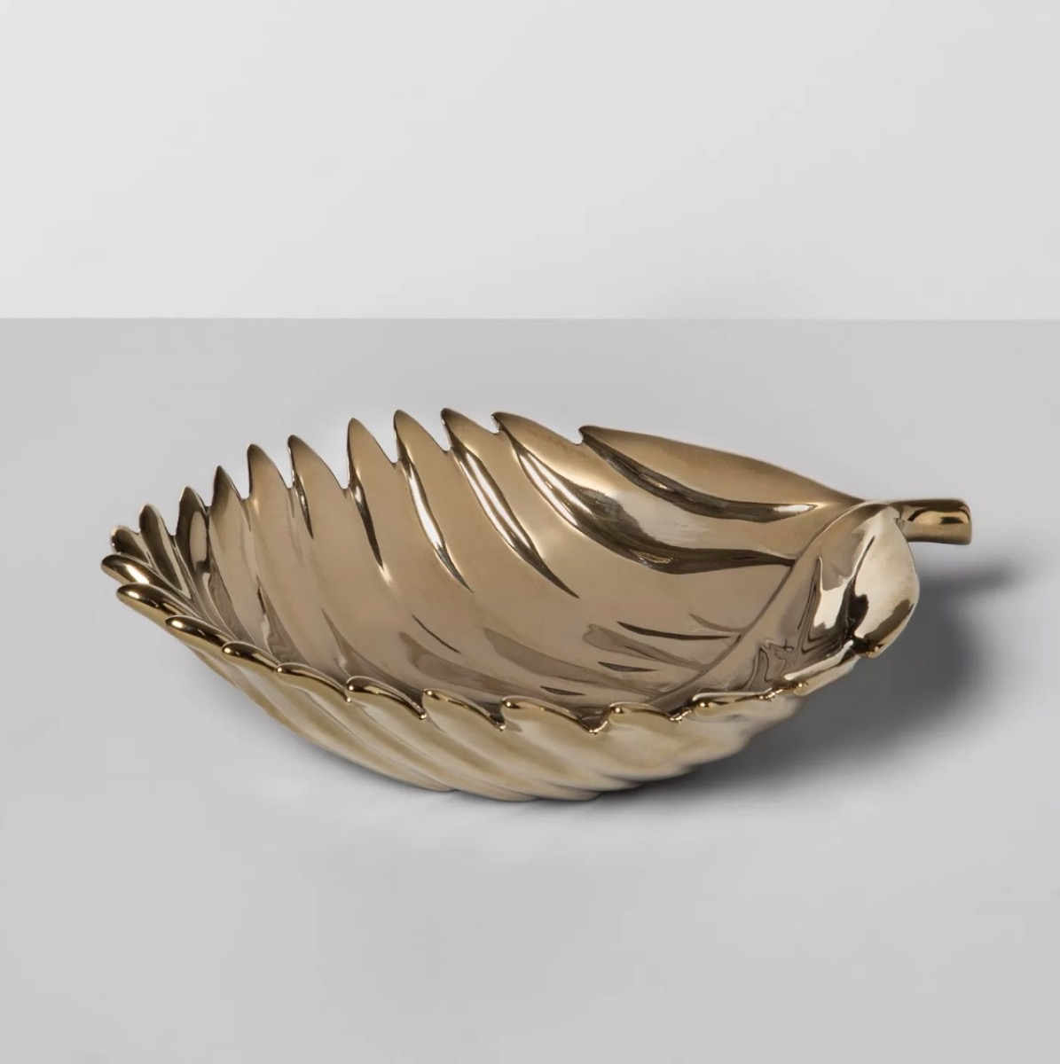 gold jewelry dish in the shape of a leaf, bathroom accessories