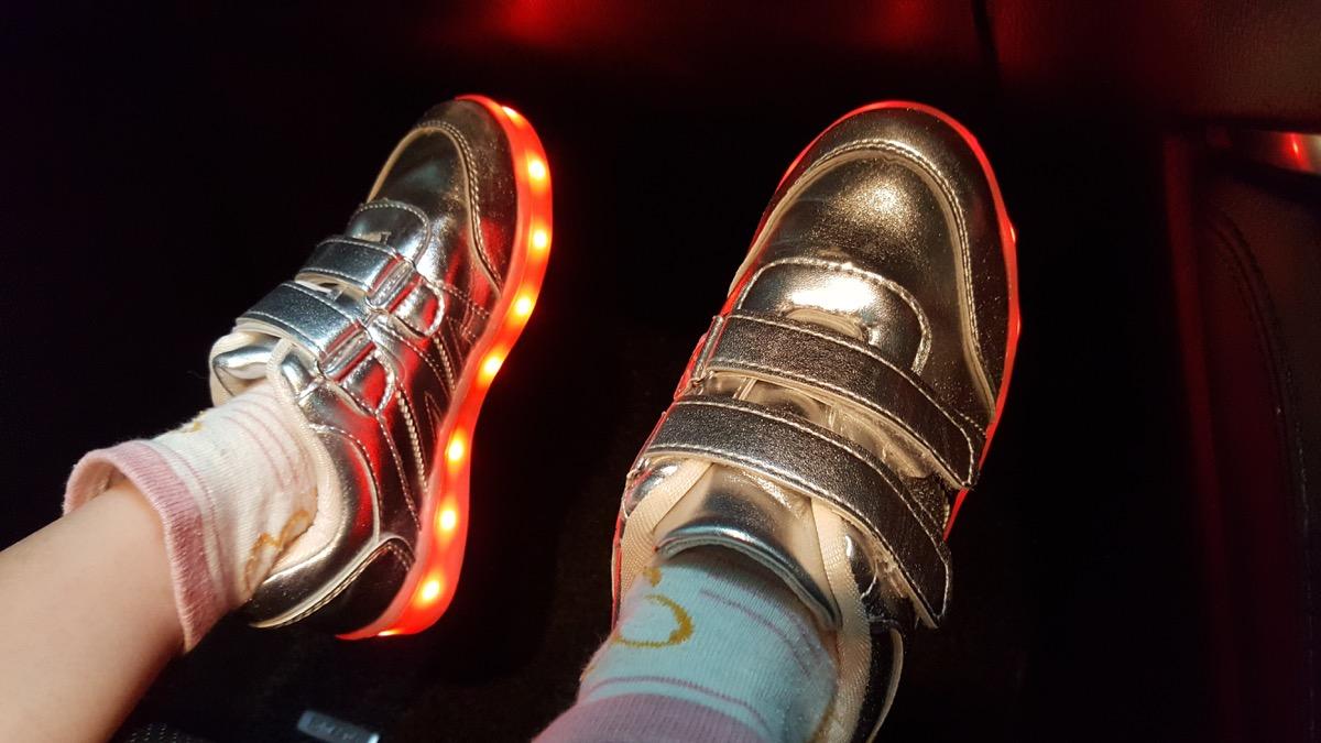 kid wearing light-up sneakers