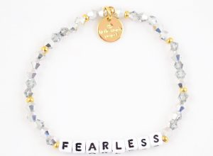 white bracelet with fearless written out in letter blocks