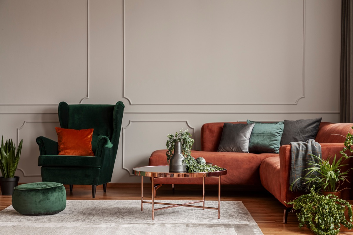 A green and orange living room space vintage home trends