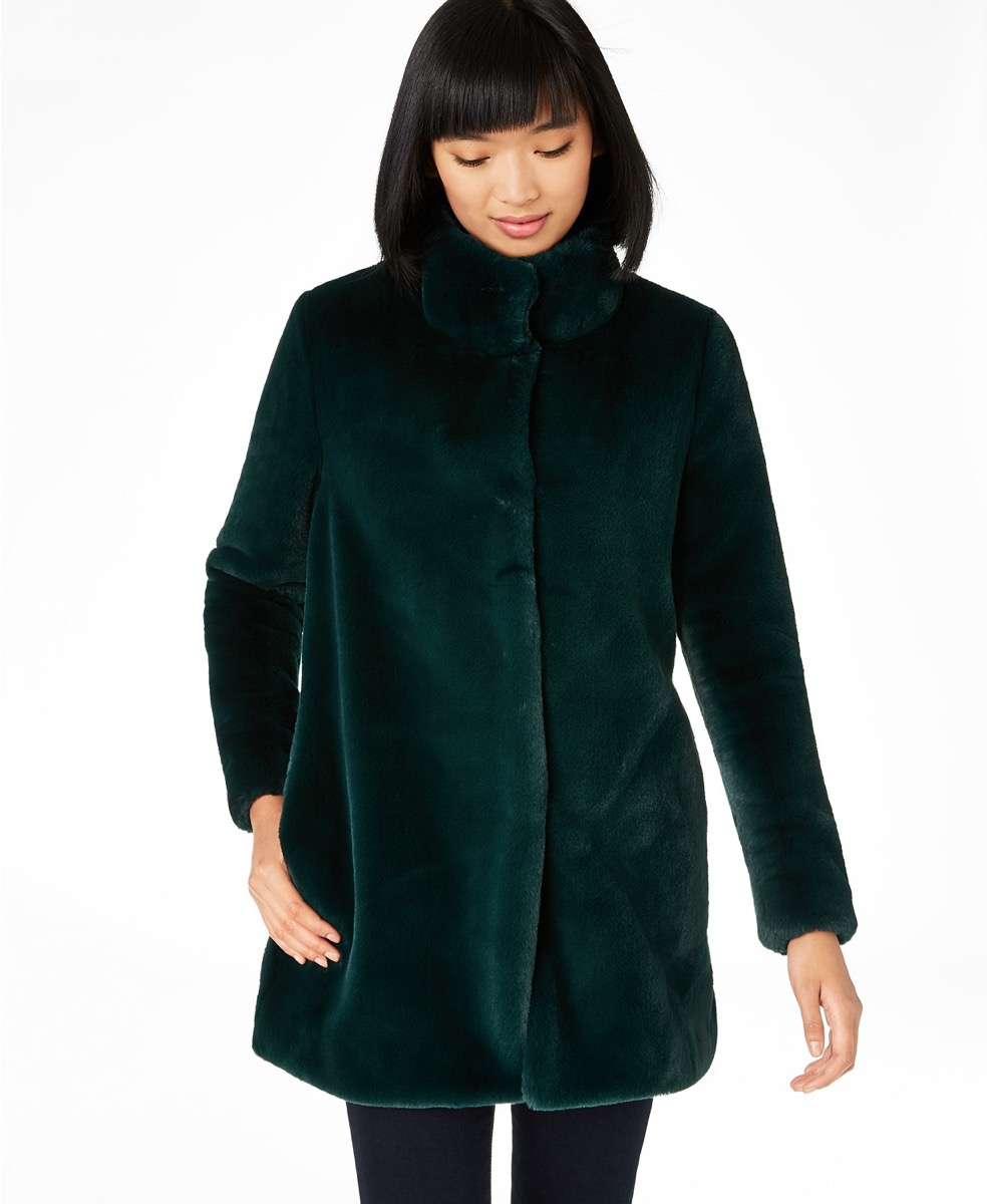 woman with black hair and bangs in green faux fur coat, women's coats for winter