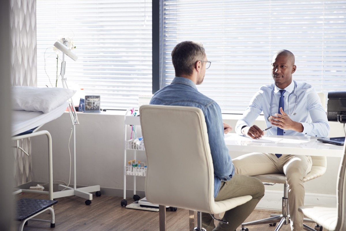 male doctor talking to his male patient