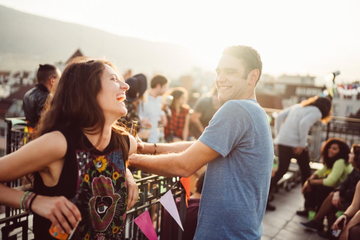 man flirting with woman at outside bar
