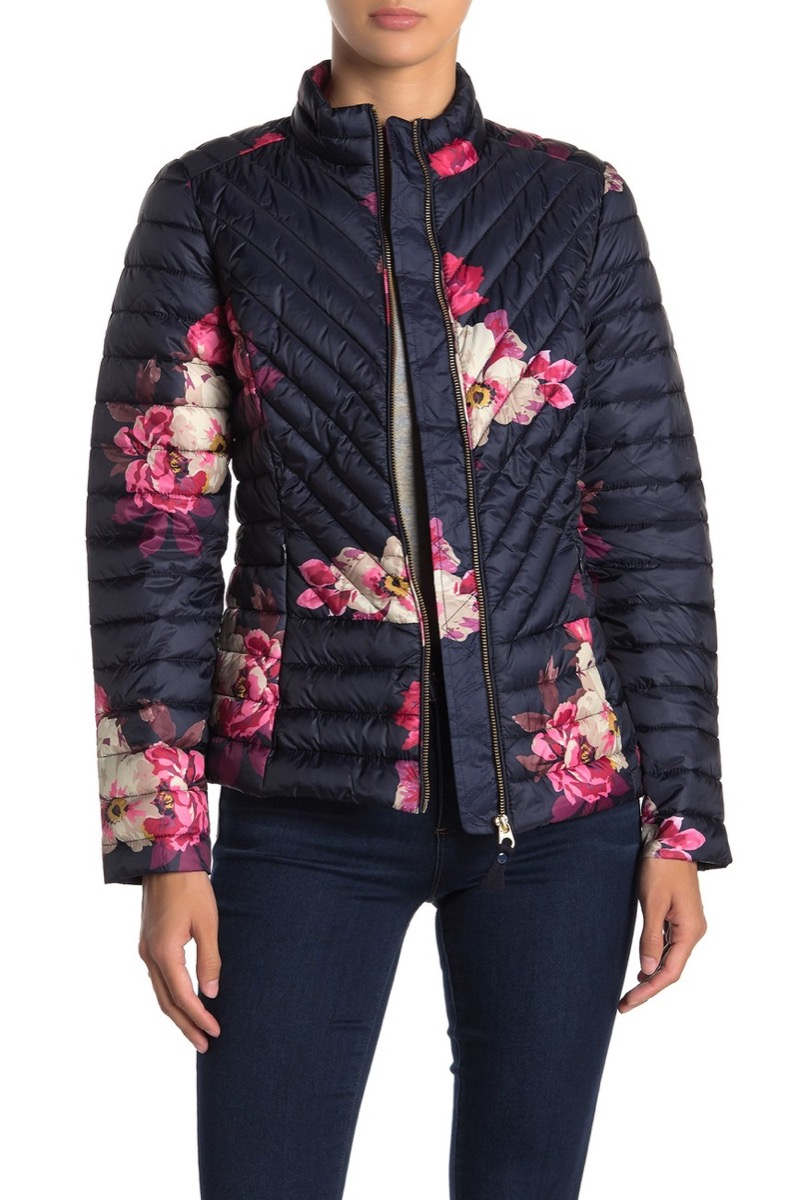 woman in black leggings and floral puffer coat, women's coats for winter