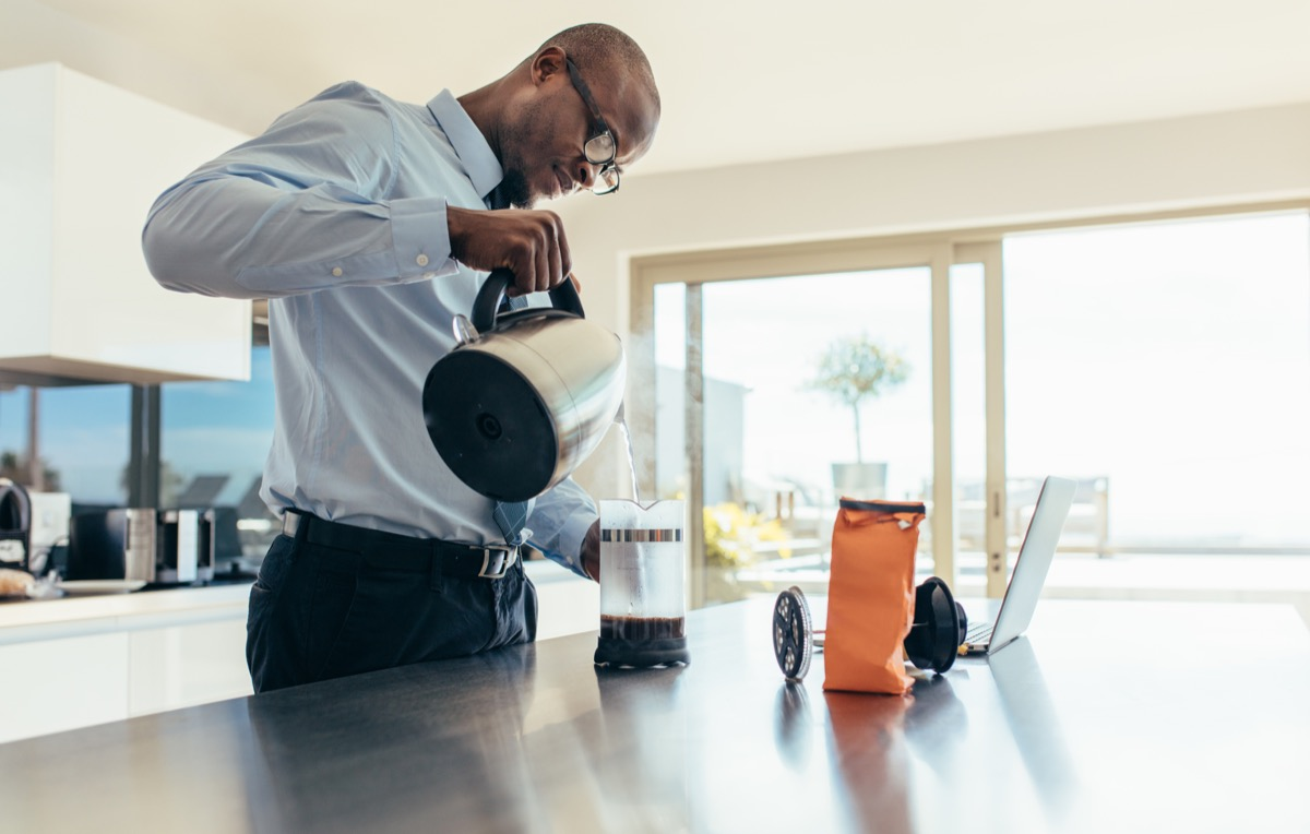 Man pouring from a coffee pot in the office, ways you're damaging teeth