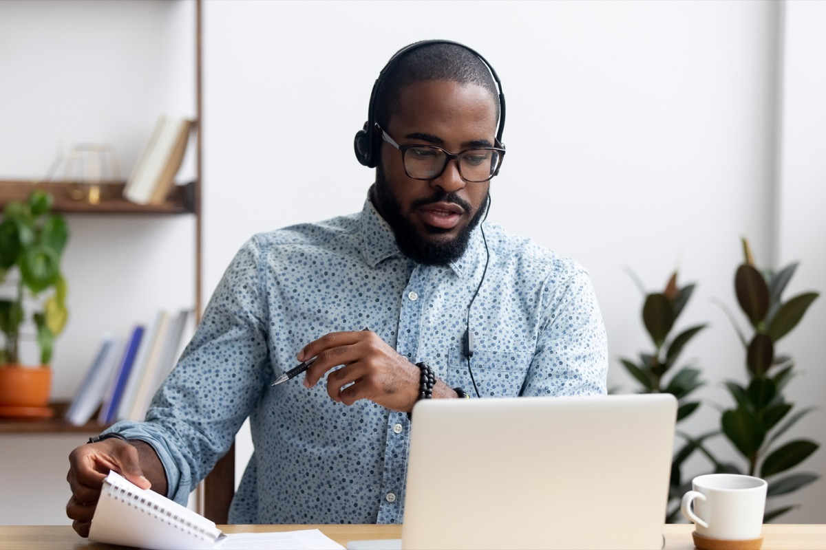 Office man working at his desk with headphones