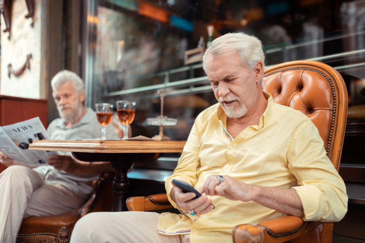 old man texting, stress signs