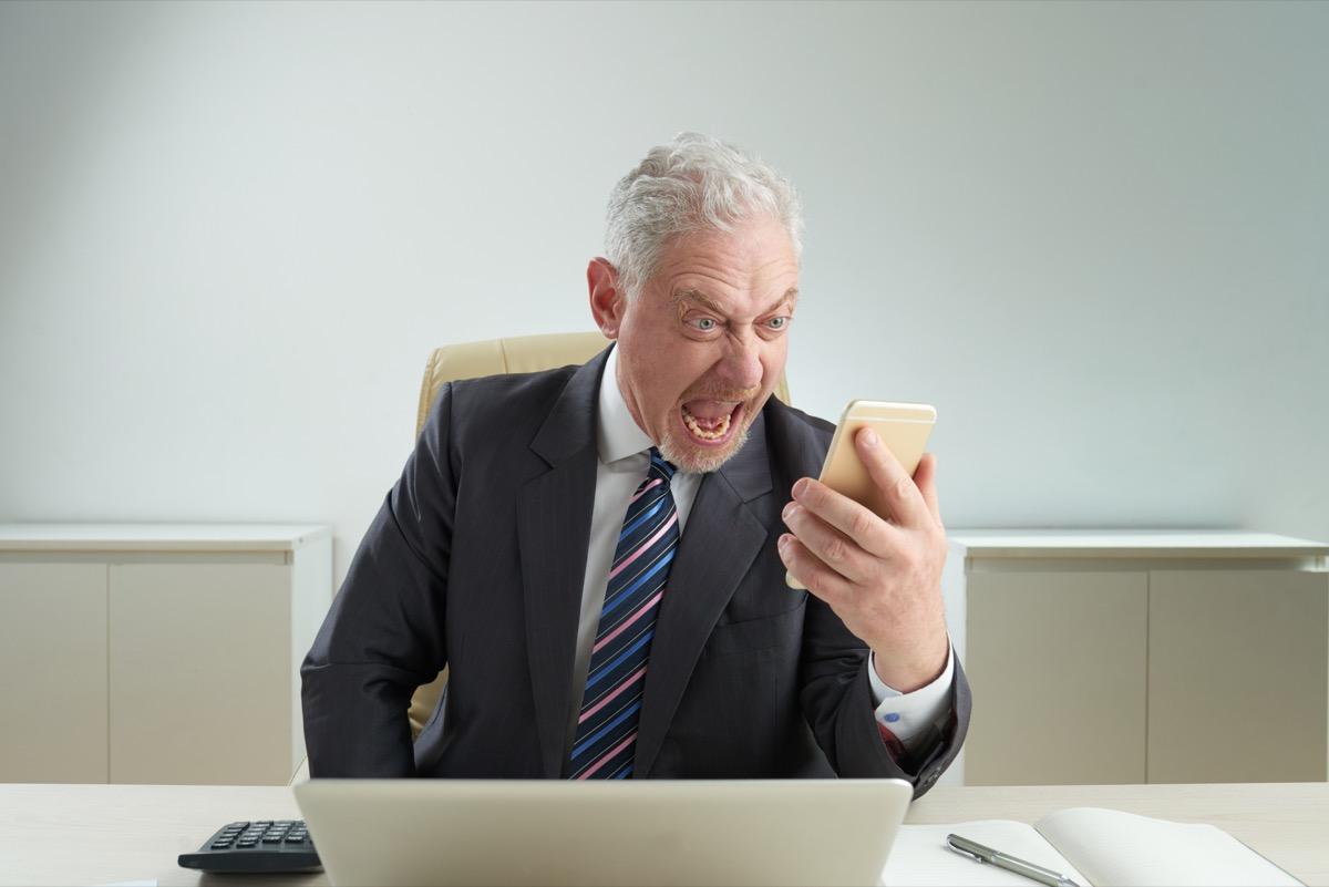 old man yelling at phone