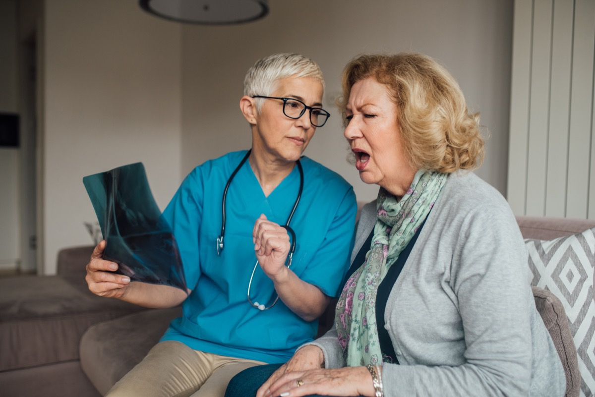 old woman looking at x-ray with doctor and asking questions