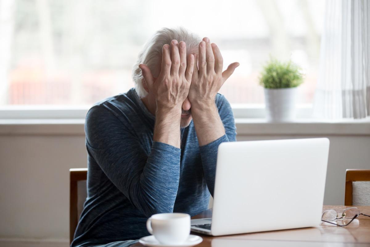 older man annoyed at laptop