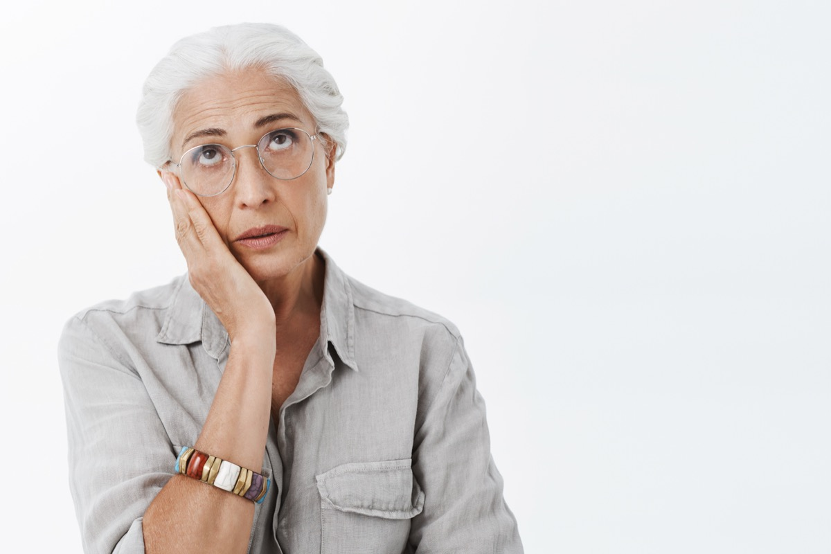 older woman sighing, stress signs
