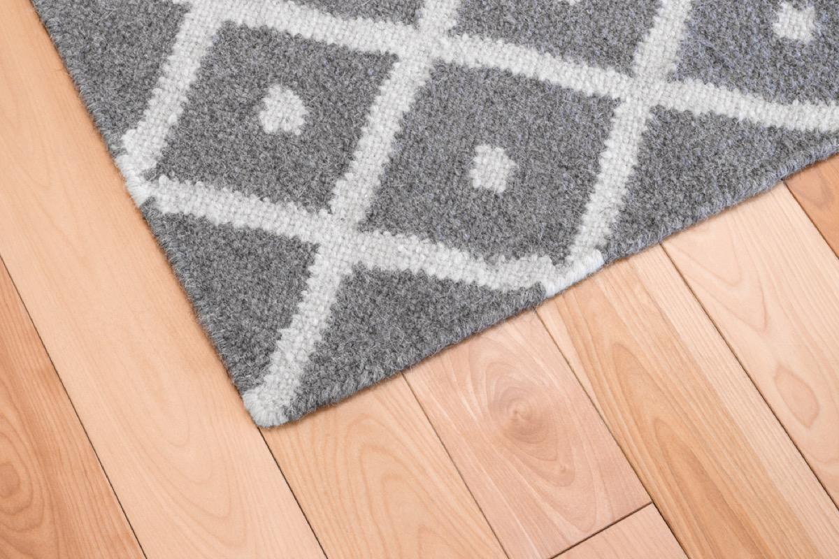 gray rug on hardwood floor, fire prevention tips