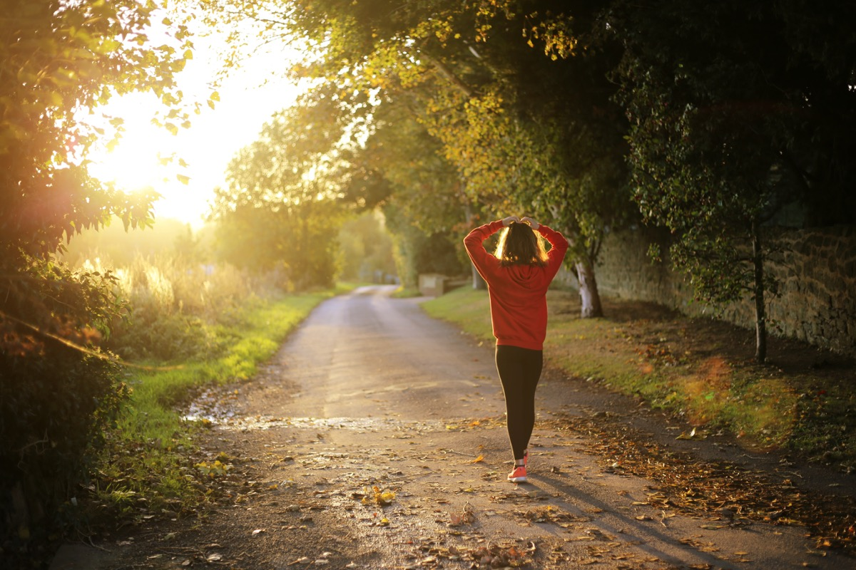 Woman running outside in the fall fall weather health