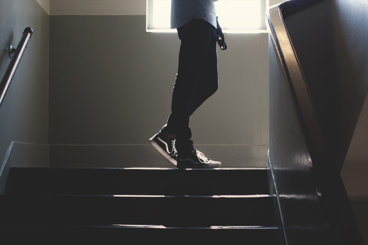 Student walking up a school stairwell classroom surfaces germs