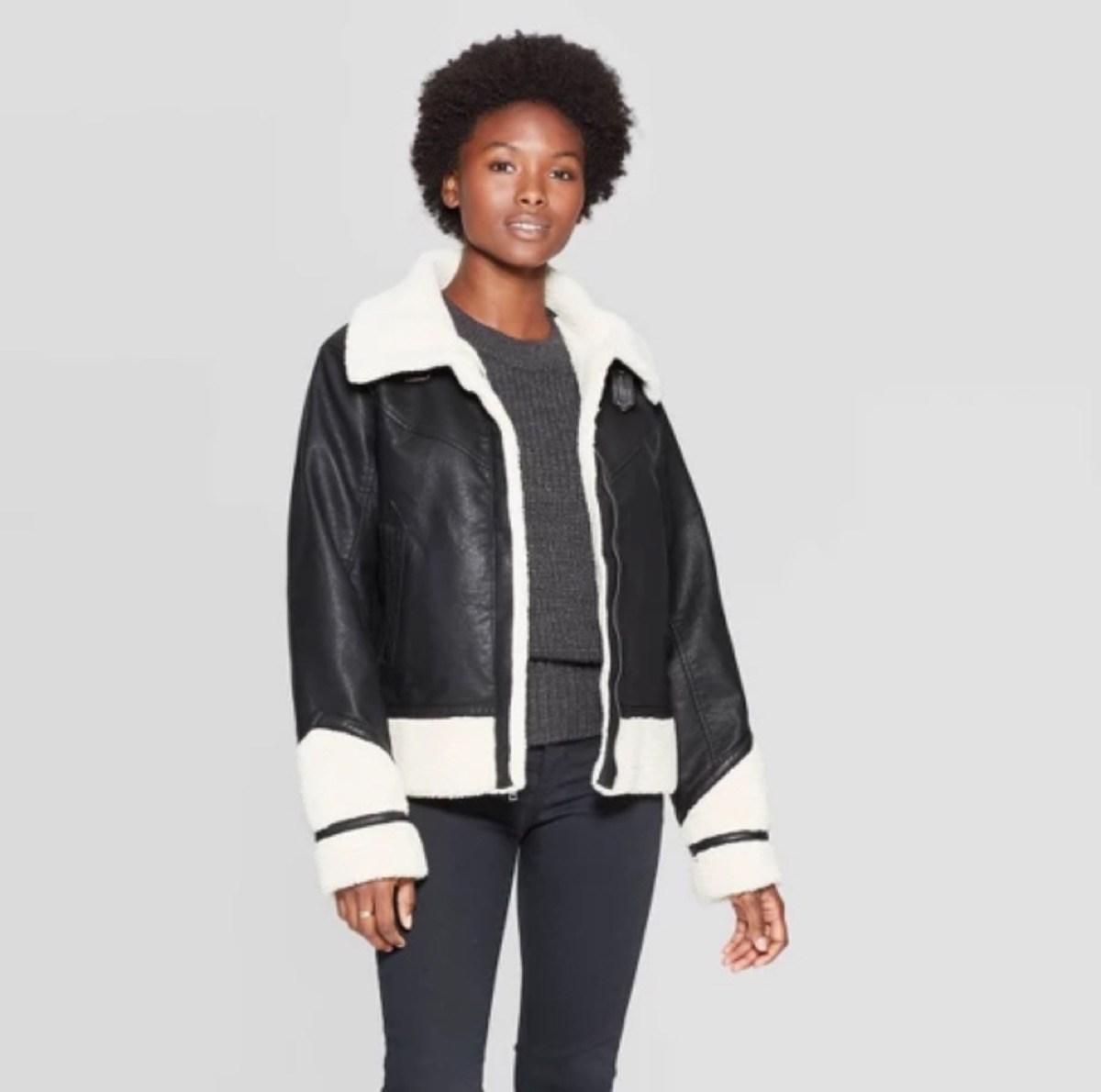 woman with black and white jacket and black leggings, women's coats for winter