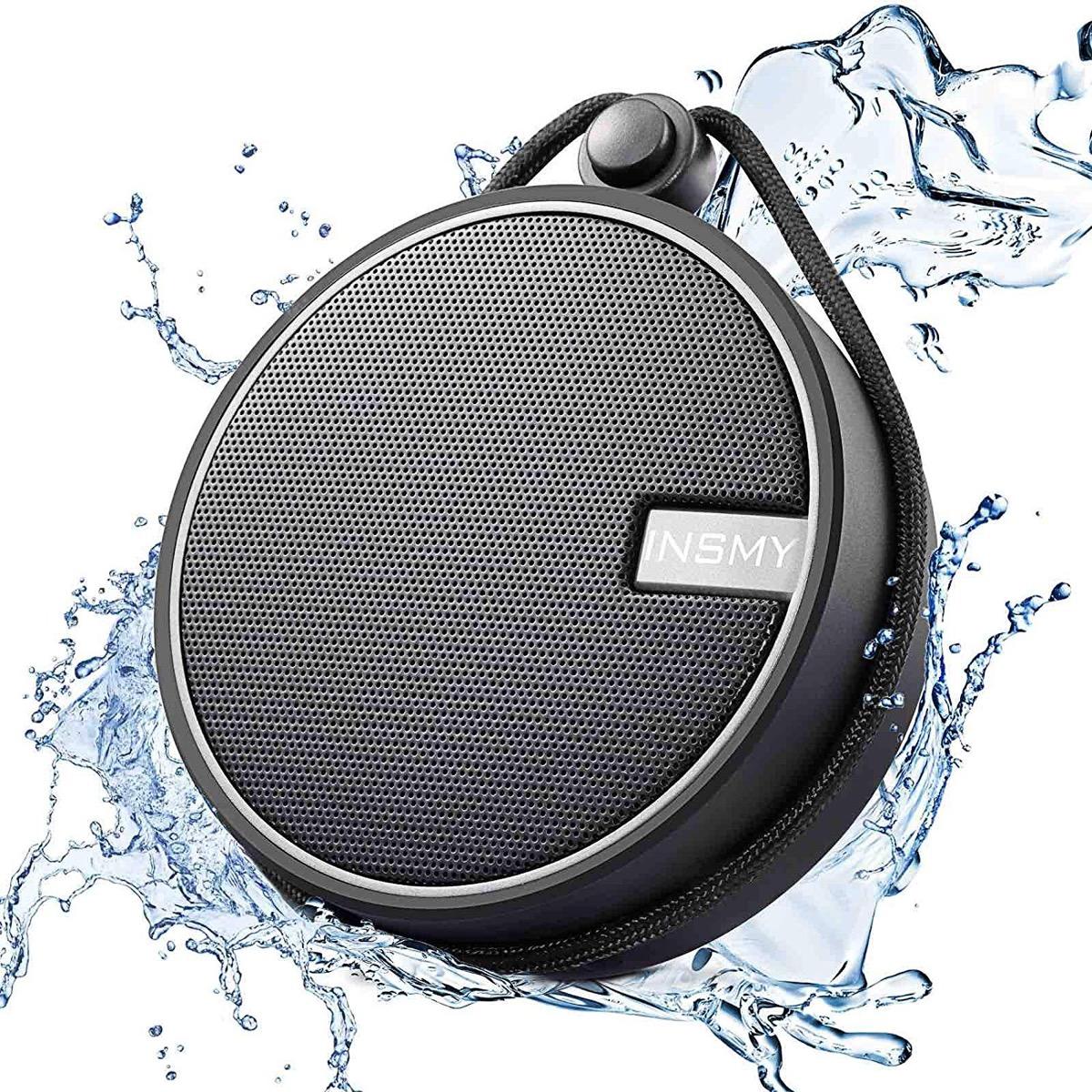black speaker with water splashing around it, bathroom accessories