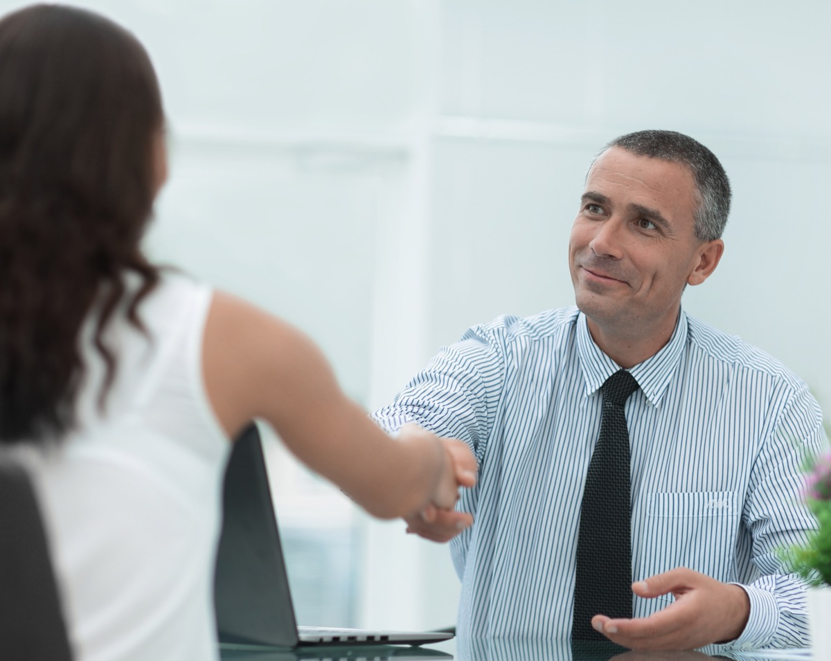 man shaking hands with customer service
