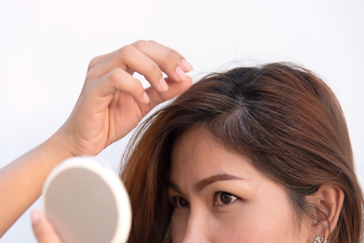 girl finding an early gray hair, hair health signs