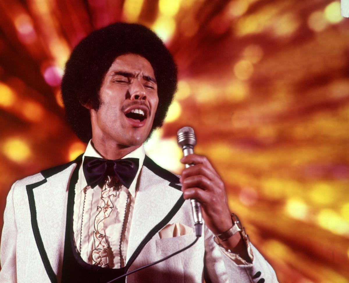 singer wearing a ruffled tuxedo
