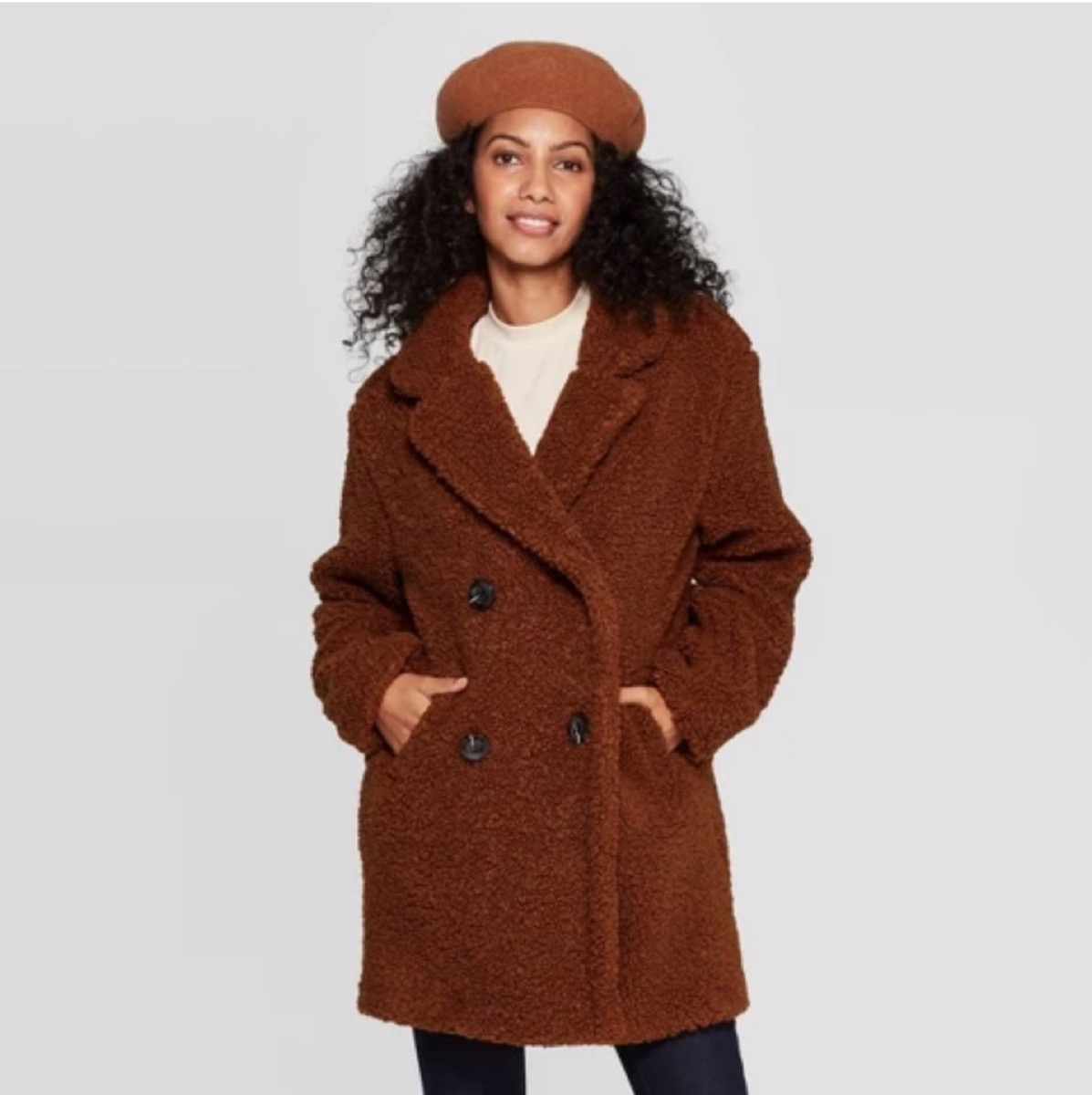 woman in brown teddy bear coat and beret, women's coats for winter