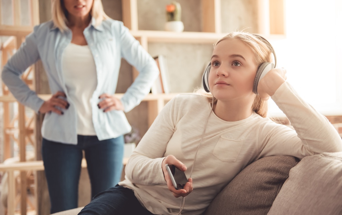 Teenager ignoring her mom who's trying to talk to her being a step-parent