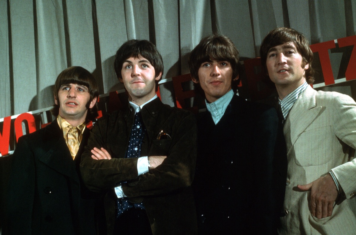 ringo starr, paul mccartney, george harrison and john lennon of the beatles posing, bands against streaming