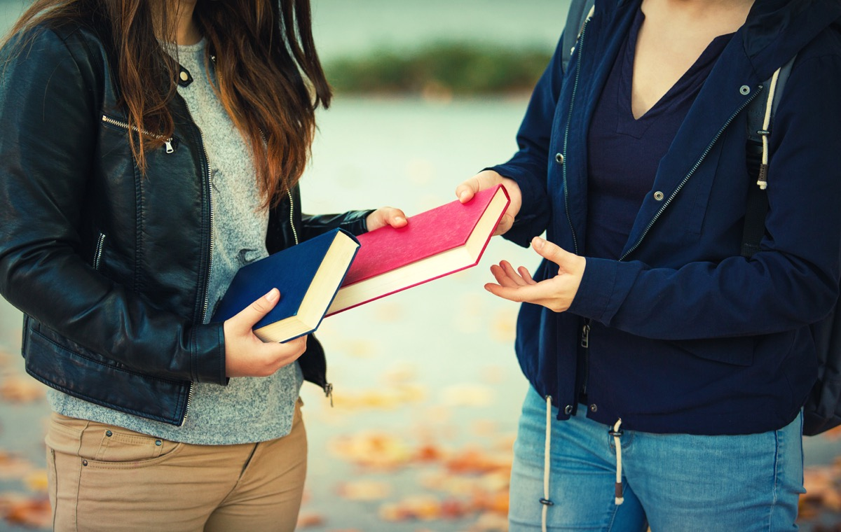 girls borrowing a book and exchanging it, old fashioned etiquette rules