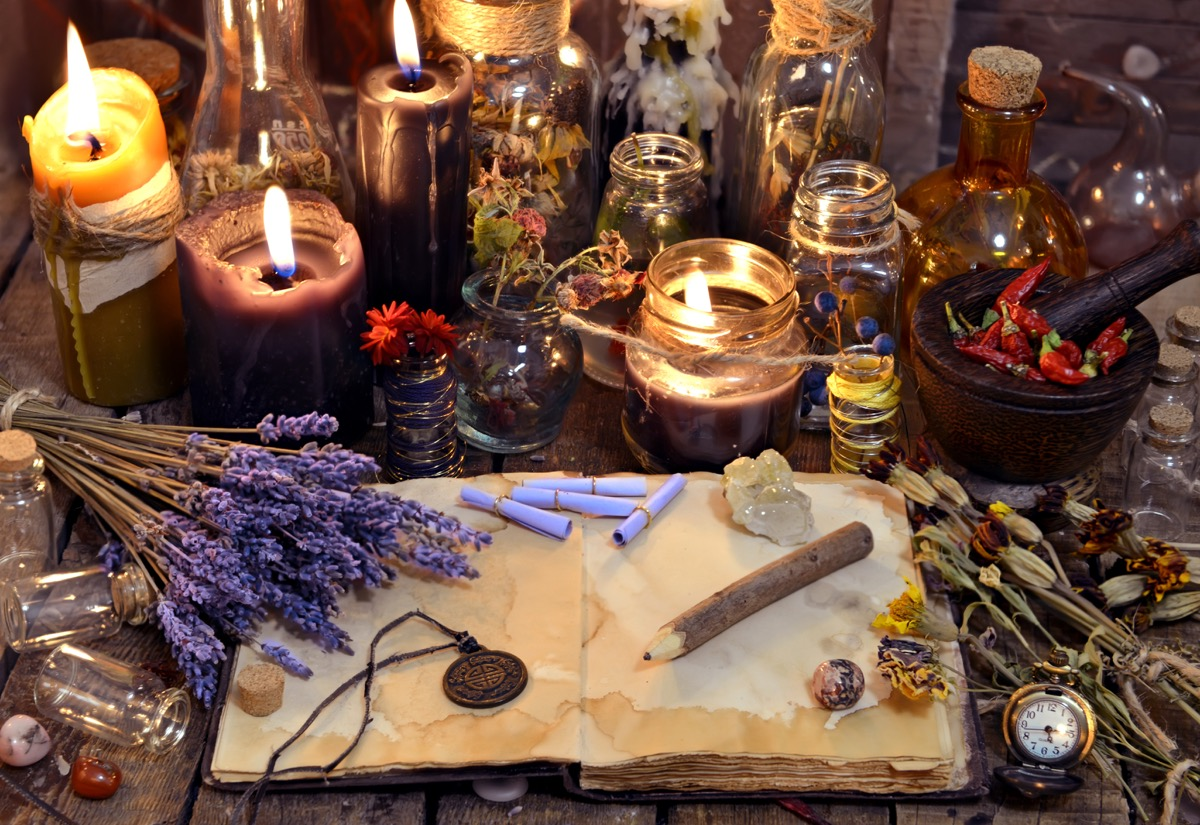 open book with healing herbs